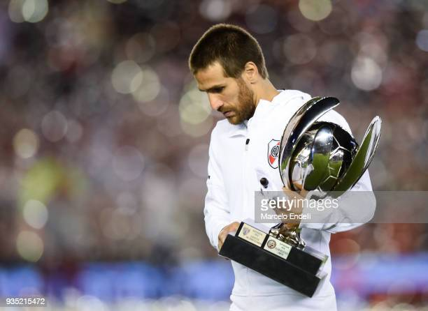 Leonardo Ponzio of River Plate walks onto the field with the Supercopa Argentina trophy before a match between River Plate and Belgrano as part of...