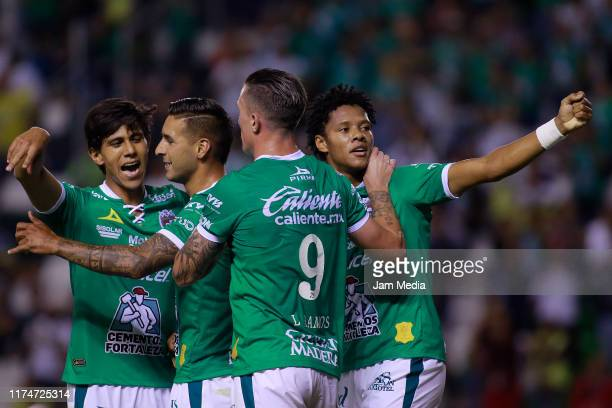 Leonardo Ramos of Leon celebrates with teammates after scoring the third goal of his team during the 9th round match between Leon and FC Juarez as...