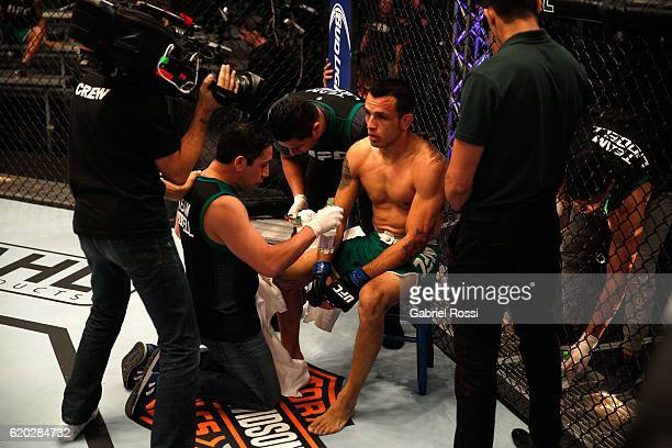 Leonardo Rodriguez receives advice from his corner inbetween rounds while facing Martin Bravo during the filming of The Ultimate Fighter Latin...