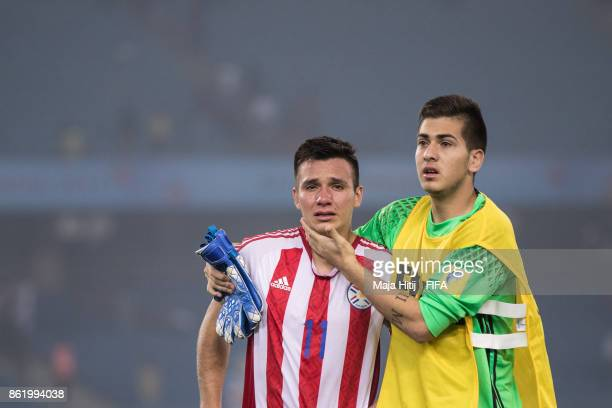 Leonardo Sanchez and Jonathan Martinez of Paraguay react after the FIFA U17 World Cup India 2017 Round of 16 match between Paraguay and USA at...