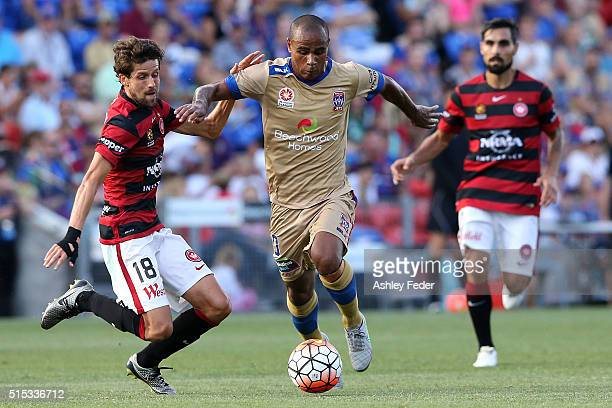 Leonardo Santiago of the Jets is contested by Andreu of the Wanderers during the round 23 ALeague match between the Newcastle Jets and the Western...