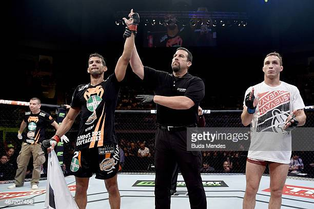 Leonardo Santos of Brazil celebrates after defeating Tony Martin of the United States in their lightweight bout during the UFC Fight Night at...