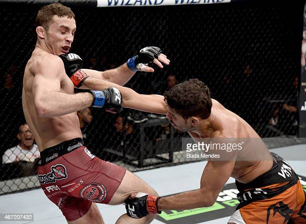 Leonardo Santos of Brazil punches Tony Martin of the United States in their lightweight bout during the UFC Fight Night at Maracanazinho Gymnasium on...