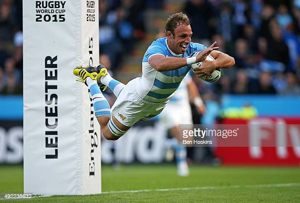 Leonardo Senatore of Argentina dives over to score a try during the 2015 Rugby World Cup Pool C match between Argentina and Namibia at Leicester City...