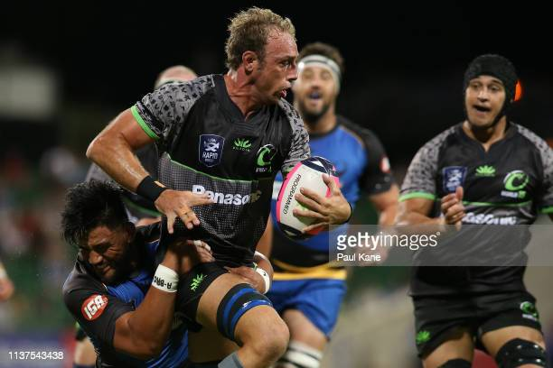 Leonardo Senatore of the World XV runs the ball while being tackled by Henry Stowers of the Force during the Global Rapid Rugby match between the...