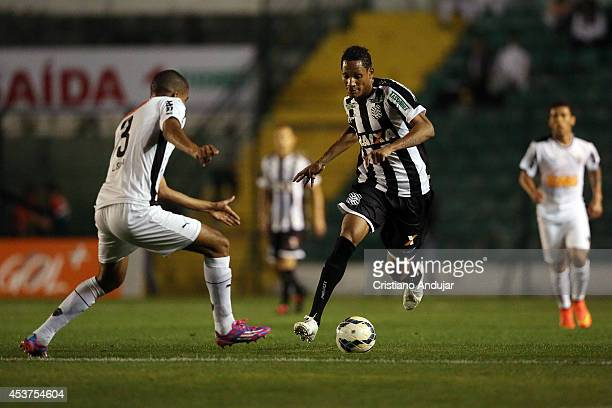 Leonardo Silva of Atletico MG try to stop Marcao of Figueirense during a match between Figueirense and Atletico MG as part of Campeonato Brasileiro...