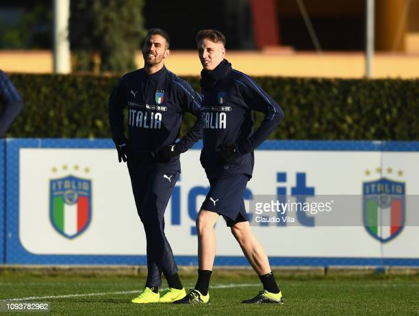 Leonardo Spinazzola and Andrea Conti of Italy in action during a training session at Centro Tecnico Federale di Coverciano on February 4 2019 in...