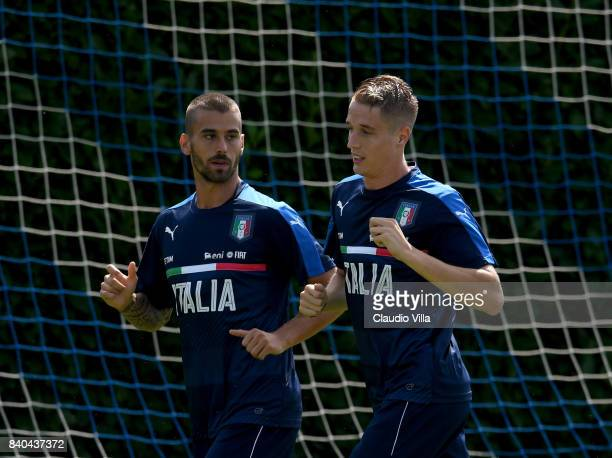 Leonardo Spinazzola and Andrea Conti of Italy in action during the traning session at Coverciano on August 29 2017 in Florence Italy