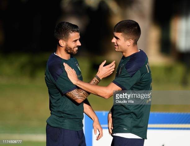 Leonardo Spinazzola and Gianluca Mancini of Italy chat during a Italy training session at Centro Tecnico Federale di Coverciano on October 8 2019 in...