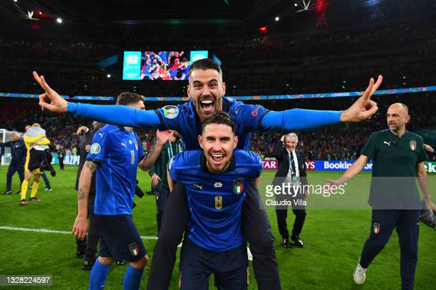 Leonardo Spinazzola and Jorginho of Italy celebrate following their team's victory in the UEFA Euro 2020 Championship Final between Italy and England...