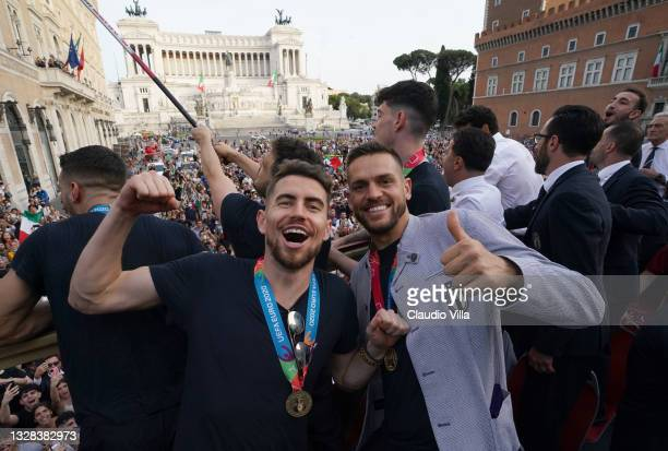 Leonardo Spinazzola and Rafael Toloi of Italy celebrate during Italy's national men's football team open-top bus victory parade, a day after Italy...