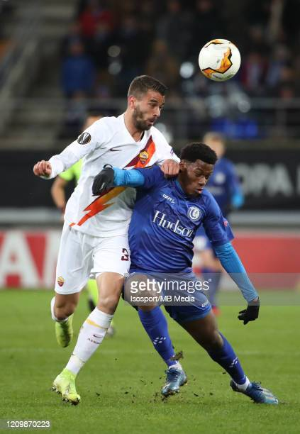Leonardo Spinazzola of AS Roma battles for the ball with Jonathan David of Kaa Gent during the UEFA Europa League round of 32 second leg match...