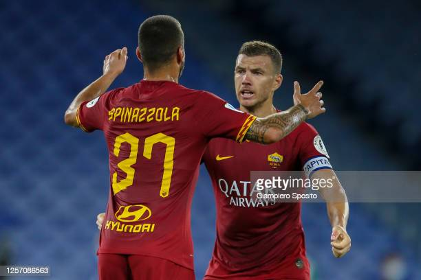 Leonardo Spinazzola of AS Roma celebrates with his captain Edin Dzeko after scoring a goal during the Serie A match between AS Roma and FC...