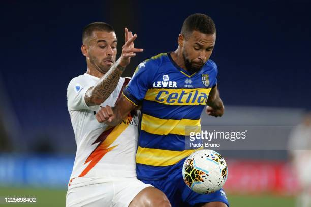 Leonardo Spinazzola of AS Roma competes for the ball with Junior Hernani of Parma Calcio during the Serie A match between AS Roma and Parma Calcio at...