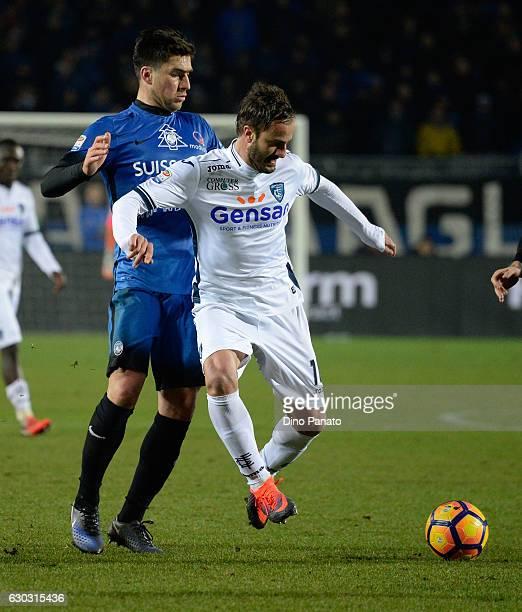 Leonardo Spinazzola of Atalanta BC competes with Alberto Gilardino of Empoli FC during the Serie A match between Atalanta BC and Empoli FC at Stadio...