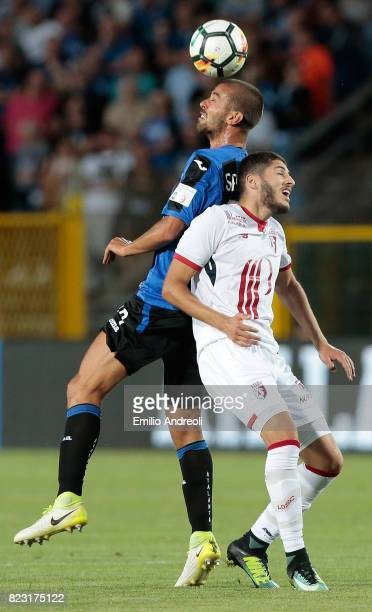 Leonardo Spinazzola of Atalanta BC jumps for the ball with Yassine Benzia of LOSC Lille during the preseason friendly match between Atalanta BC and...