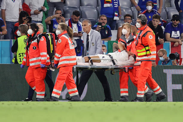 Leonardo Spinazzola of Italy is carried off on a stretcher during the UEFA Euro 2020 Championship Quarter-final match between Belgium and Italy at...