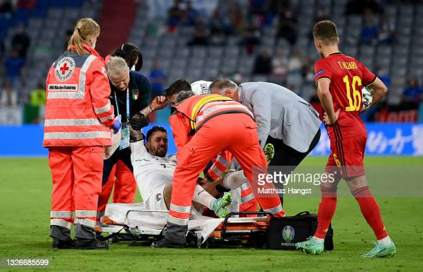 Leonardo Spinazzola of Italy is helped by medical staff on to a stretcher during the UEFA Euro 2020 Championship Quarter-final match between Belgium...