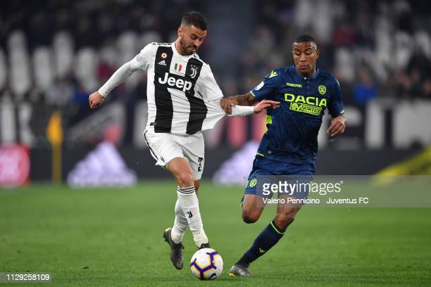 Leonardo Spinazzola of Juventus competes for the ball with Marvin Zeegelaar of Udinese during the Serie A match between Juventus and Udinese at...