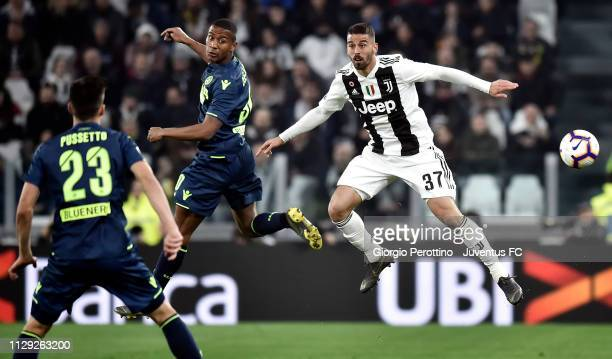 Leonardo Spinazzola of Juventus goes up with Marvin Zeegelaar of Udinese during the Serie A match between Juventus and Udinese at Allianz Stadium on...