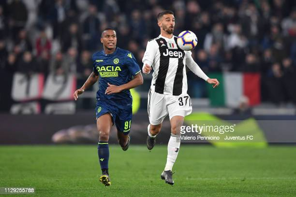 Leonardo Spinazzola of Juventus hits the ball with his chest to keep control during the Serie A match between Juventus and Udinese at Allianz Stadium...