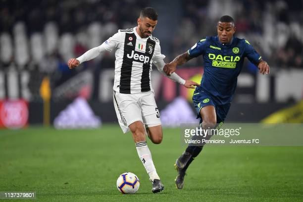 Leonardo Spinazzola of Juventus is challenged by Marvin Zeegelaar of Udinese during the Serie A match between Juventus and Udinese at Allianz Stadium...