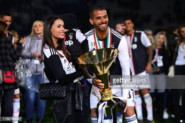Leonardo Spinazzola of Juventus poses with the Serie A trophy alongside his family following the Serie A match between Juventus and Atalanta BC at...