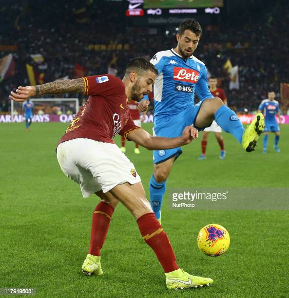 Leonardo Spinazzola of Roma and Amin Younes of Napoli and during the Serie A match AS Roma v SSC Napoli at the Olimpico Stadium in Rome Italy on...