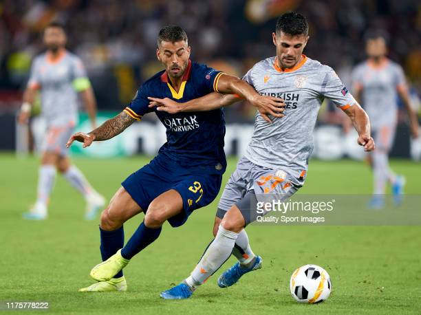 Leonardo Spinazzola of Roma competes for the ball with Danijel Aleksic of Istanbul Basaksehir during the UEFA Europa League group J match between AS...