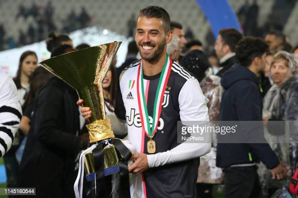 Leonardo Spinazzola with the trophy of Scudetto during the victory ceremony following the Italian Serie A last football match of the season Juventus...