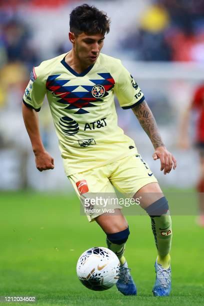 Leonardo Suarez of America drives the ball during a quarter final first leg match between Club America and Atlanta United as part of CONCACAF...