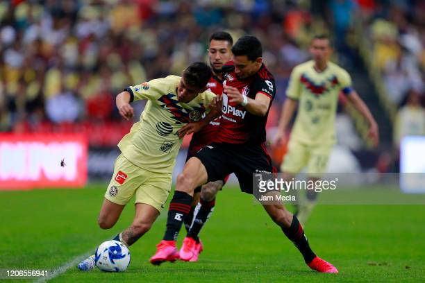 Leonardo Suarez of America fights for the ball with Ismael Govea of Atlas during the 6th round match between America and Atlas as part of the Torneo...
