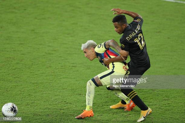 Leonardo Suarez of Club America and Diego Palacios of Los Angeles FC fight for the ball during the CONCACAF Champions League semifinal game at...