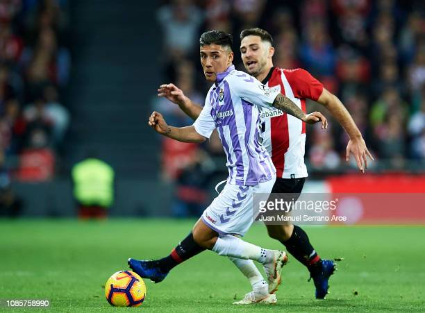 Leonardo Suarez of Real Valladolid CF competes for the ball with Yerran Alvarez of Athletic Club during the La Liga match between Athletic Club and...