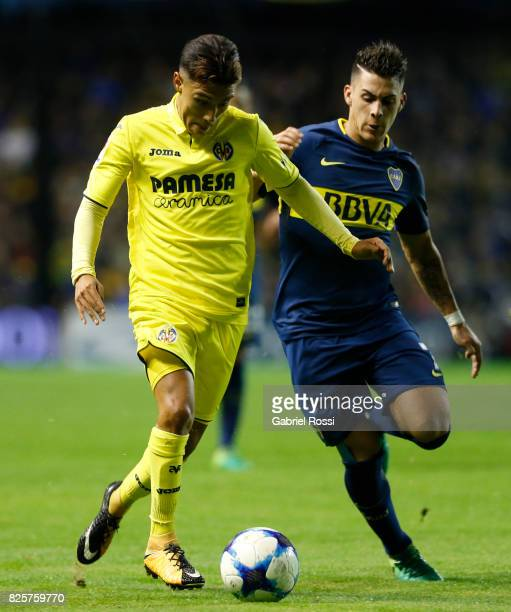 Leonardo Suarez of Villarreal CF fights for the ball with Cristian Pavon of Boca Juniors during the international friendly match between Boca Juniors...