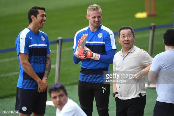 Leonardo Ulloa and Kasper Schmiechel speak to Leicester City Chairman Vichai Srivaddhanaprabha during a Leicester City training session ahead of...