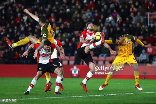 Leonardo Ulloa of Brighton and Hove Albion attempts to head the ball as Jack Stephens of Southampton attempts to clear during the Premier League...