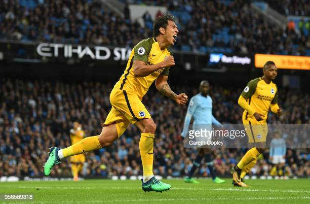 Leonardo Ulloa of Brighton and Hove Albion celebrates after scoring his sides first goal during the Premier League match between Manchester City and...