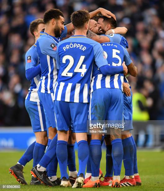 Leonardo Ulloa of Brighton and Hove Albion celebrates scoring his side's third goal with team mates during the The Emirates FA Cup Fifth Round...