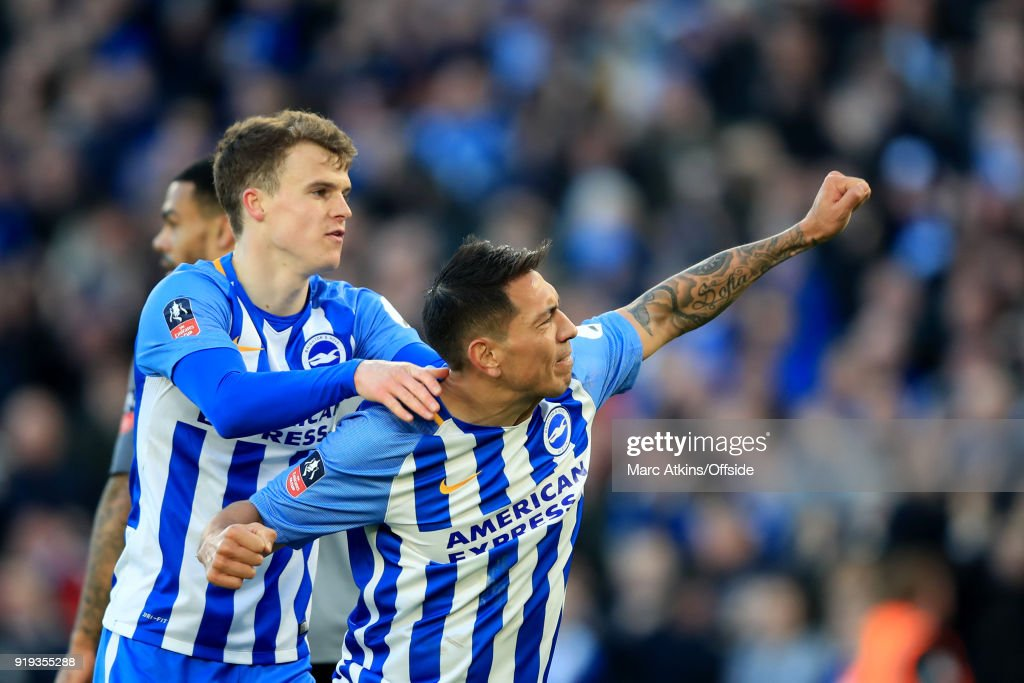 Leonardo Ulloa of Brighton and Hove Albion celebrates scoring their 3rd goal with Solly March during the FA Cup Fifth Round match between Brighton and Hove Albion and Coventry City at Amex Stadium on February 17, 2018 in Brighton, England.