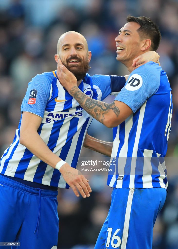 Leonardo Ulloa of Brighton and Hove Albion celebrates scoring their 3rd goal with Bruno Saltor during the FA Cup Fifth Round match between Brighton and Hove Albion and Coventry City at Amex Stadium on February 17, 2018 in Brighton, England.