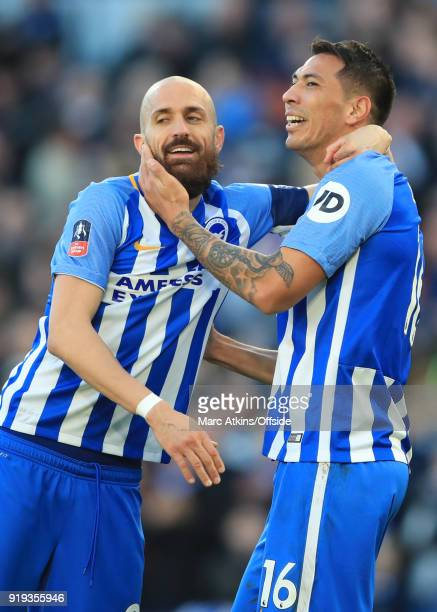 Leonardo Ulloa of Brighton and Hove Albion celebrates scoring their 3rd goal with Bruno Saltor during the FA Cup Fifth Round match between Brighton...
