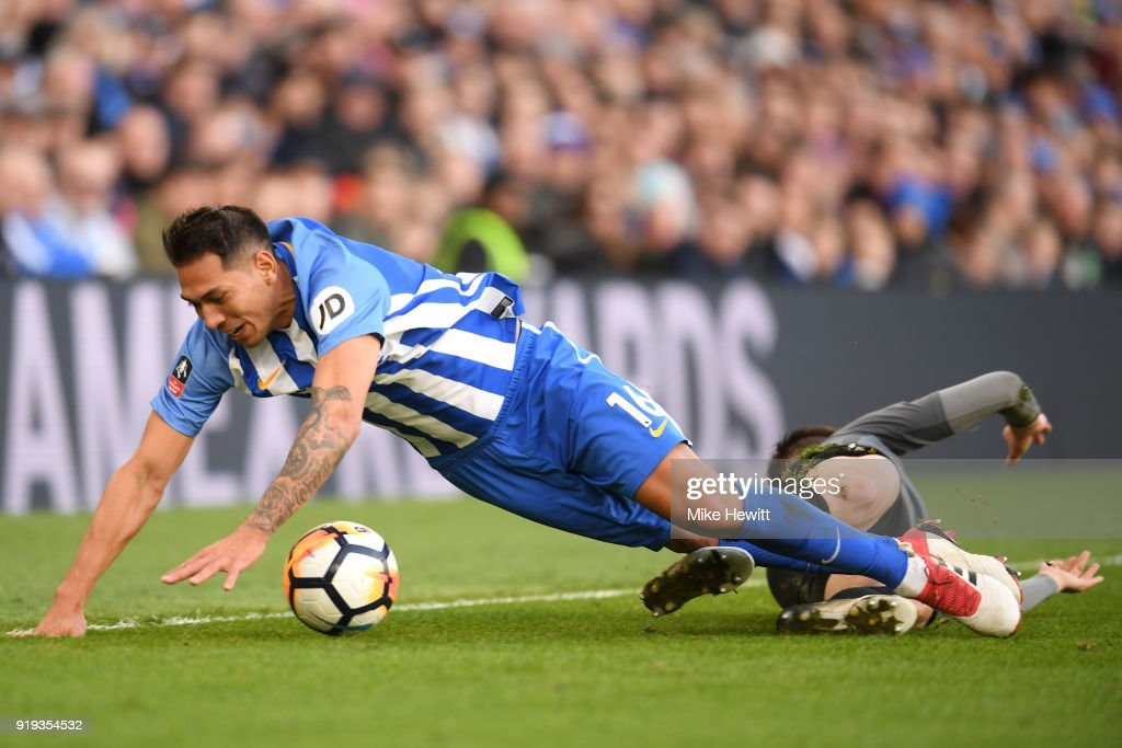 Leonardo Ulloa of Brighton and Hove Albion falls on Dominic Hyam of Coventry City after fouling him during the The Emirates FA Cup Fifth Round between Brighton and Hove Albion v Coventry City at Amex Stadium on February 17, 2018 in Brighton, England.