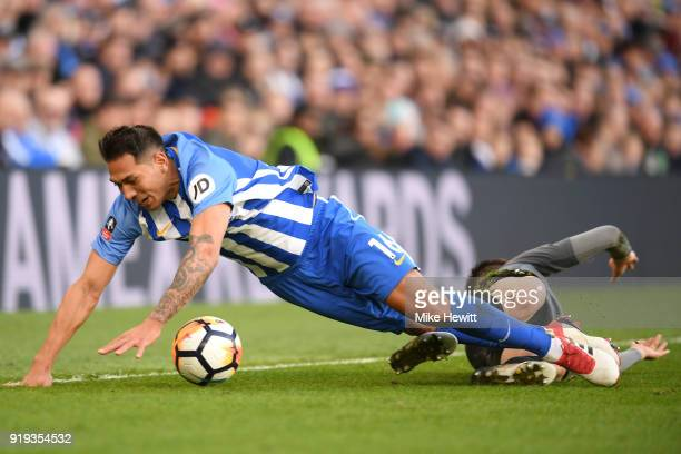 Leonardo Ulloa of Brighton and Hove Albion falls on Dominic Hyam of Coventry City after fouling him during the The Emirates FA Cup Fifth Round...