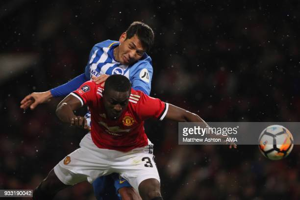 Leonardo Ulloa of Brighton Hove Albion and Eric Bailly of Manchester United during the FA Cup Quarter Final match between Manchester United and...