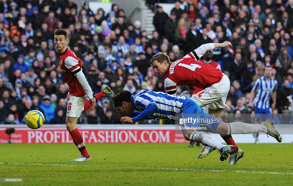 Leonardo Ulloa of Brighton & Hove Albion beats Per Mertesacker of Arsenal to score their second goal with a diving header during the FA Cup with Budweiser Fourth Round match between Brighton & Hove Albion and Arsenal at Amex Stadium on January 26, 2013 in Brighton, England.