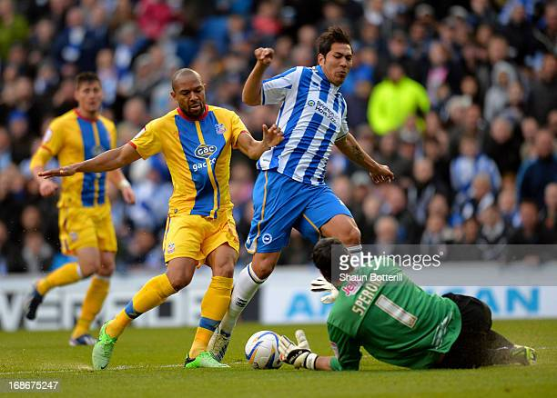 Leonardo Ulloa of Brighton Hove Albion is tackled by Danny Gabbidon and goalkeeper Julian Speroni of Crystal Palace during the npower Championship...