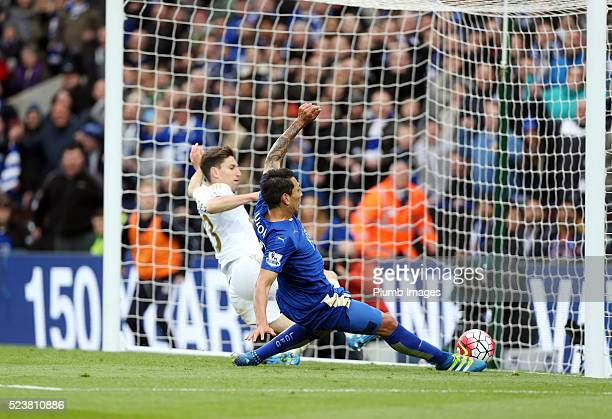 Leonardo Ulloa of Leicester City beats Federico Fernandez of Swansea to the ball to score to make it 30 during the Barclays Premier League match...