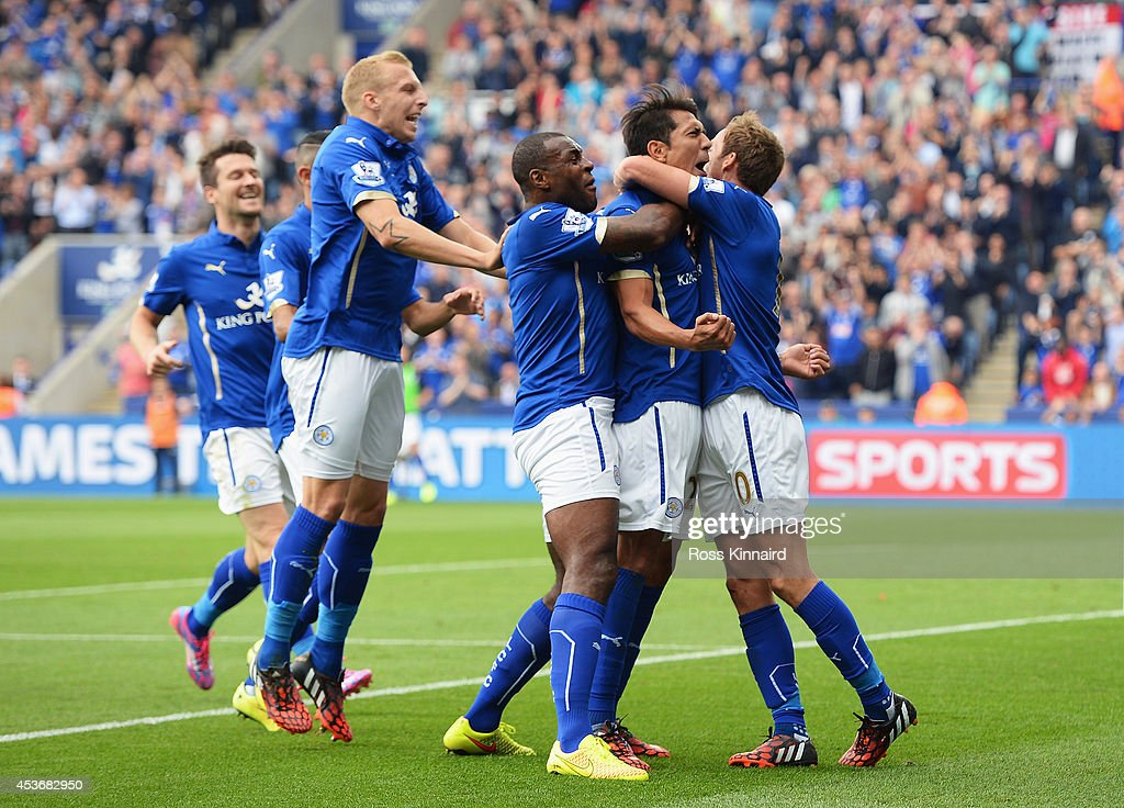Leonardo Ulloa (2ndR) of Leicester City celebrates scoring his goal with team mates during the Barclays Premier League match between Leicester City and Everton at the King Power Stadium on August 16, 2014 in Leicester, England.