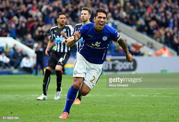 Leonardo Ulloa of Leicester City celebrates scoring his team's third goal from the penalty spot during the Barclays Premier League match between...